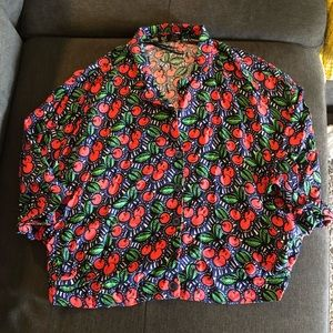 Cherry dressy shirt cut shirt with short sleeves.